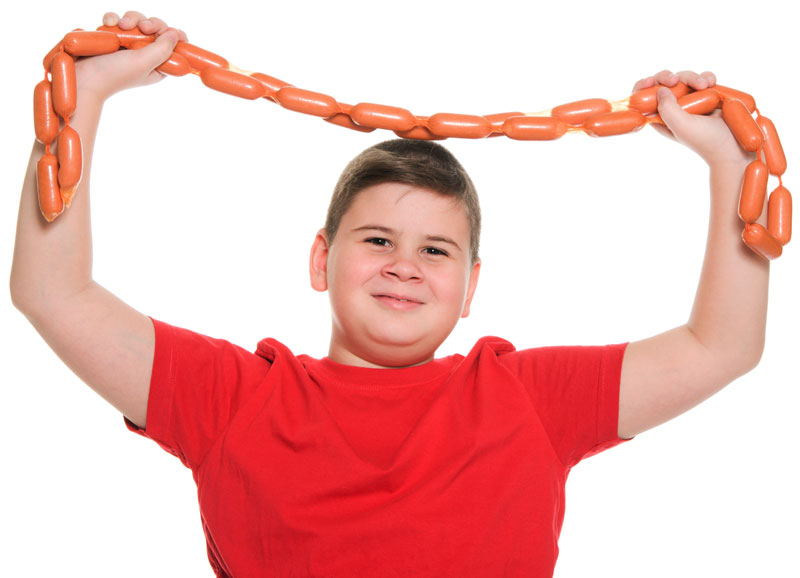 child holding sausage
